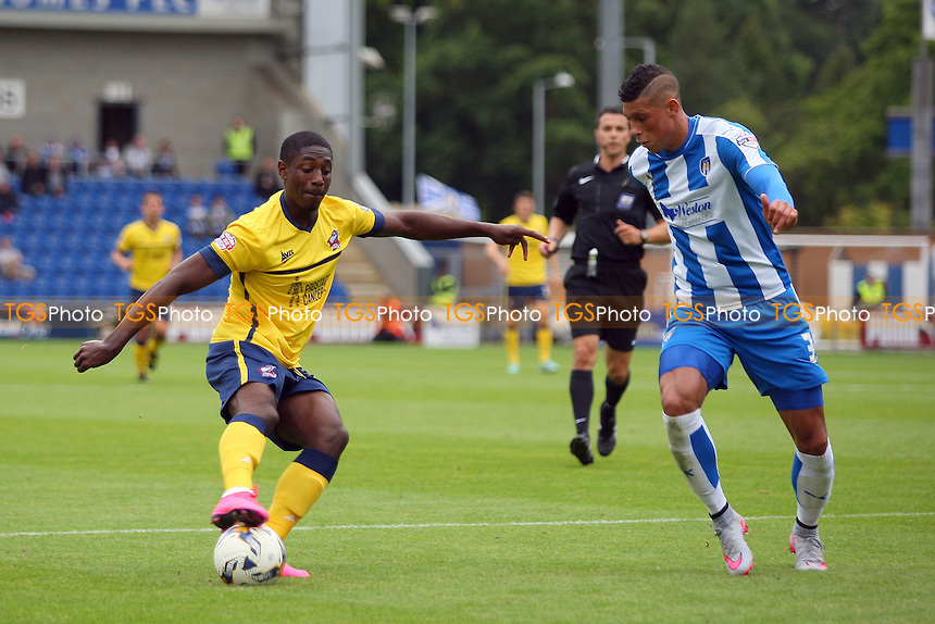 Hakeeb Adelakun of Scunthorpe United takes on Matthew Briggs of Colchester United during Colchester United vs Scunthorpe United, Sky Bet League 1 Football at the Weston Homes Community Stadium, Colchester, England on 29/08/2015