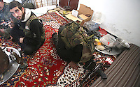 Photographer: Rick Findler/Borderline News..17.01.13 Soldiers belonging to the Free Syrian Army drink tea and undertake afternoon prayers after a mission to have a closer look at Minnagh Military Airport. They are hoping to plan an offensive attack to take the airport from Assad control outside of Aleppo, Northern Syria.