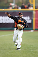 Miguel Tejada #10 of the San Francisco Giants warms up before the game against the Arizona Diamondbacks in the first spring training game of the season at Scottsdale Stadium on February 25, 2011  in Scottsdale, Arizona. .Photo by:  Bill Mitchell/Four Seam Images.