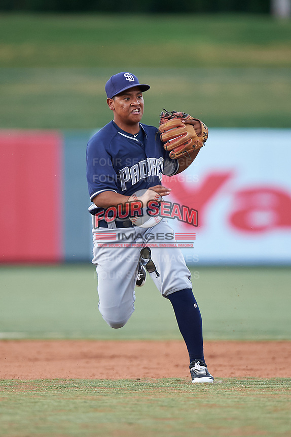 Shortstop Bryan Torres (12), of the AZL Padres 1, makes a running throw to first base during an Arizona League game against the AZL Angels on August 5, 2019 at Tempe Diablo Stadium in Tempe, Arizona. AZL Padres 1 defeated the AZL Angels 5-0. (Zachary Lucy/Four Seam Images)