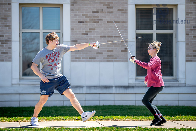 April 19, 2018; Mick Assaf and Lottie VanderGoot rehearse a scene outside the DeBartolo Performing Arts Center for their Stage Combat class. (Photo by Matt Cashore/University of Notre Dame)