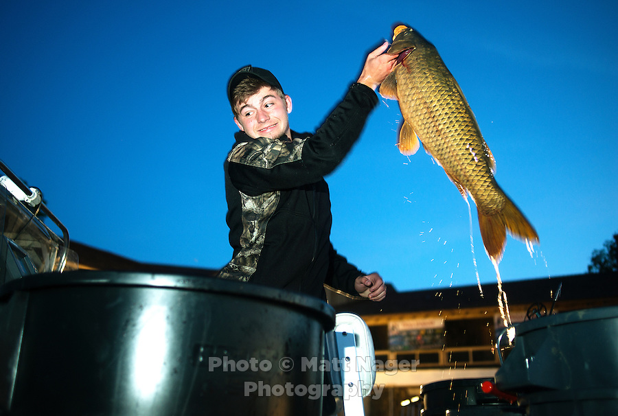 Lucas Patterson (cq) with team Thrill Billy Bow Fishing, from Indiana, chooses carp for his weigh in, after the U.S. Open Bowfishing Championship, Sunday, May 4, 2014. <br /> <br /> Photo by Matt Nager