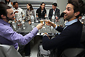 Guests toast with Absolut Vodka martinies at a private diner provided bye Absolut Vodka at a private location on Nov 12, 2010. ( For Pernod Ricard)