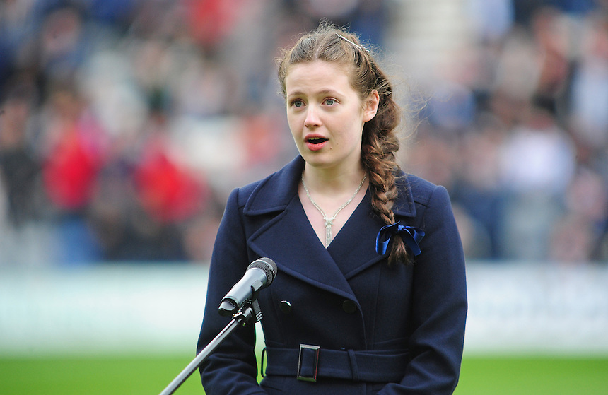 BC Young Chorister of the Year Louisa Stirland  performs on the Deepdale pitch before kick off<br /> <br /> Photographer Chris Vaughan/CameraSport<br /> <br /> Football - The Football League Sky Bet League One Play-Off First Leg - Preston North End v Rotherham United - Saturday 10th May 2014 - Deepdale - Preston<br /> <br /> &copy; CameraSport - 43 Linden Ave. Countesthorpe. Leicester. England. LE8 5PG - Tel: +44 (0) 116 277 4147 - admin@camerasport.com - www.camerasport.com