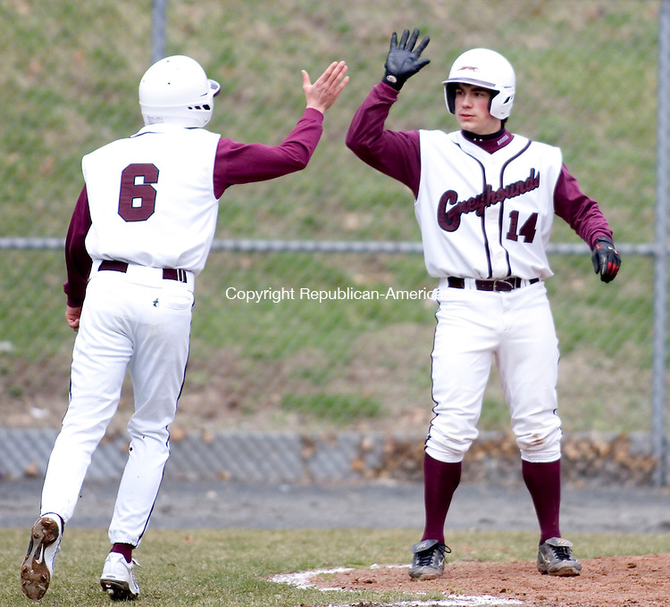 NAUGATUCK, CT- 05 APRIL 07- 040507JT15- <br /> Naugatuck's Steve Webb, left, and Rick Cool high-five after scoring runs during Thursday's game against Torrington. Naugatuck who won 11-1.<br /> Josalee Thrift Republican-American