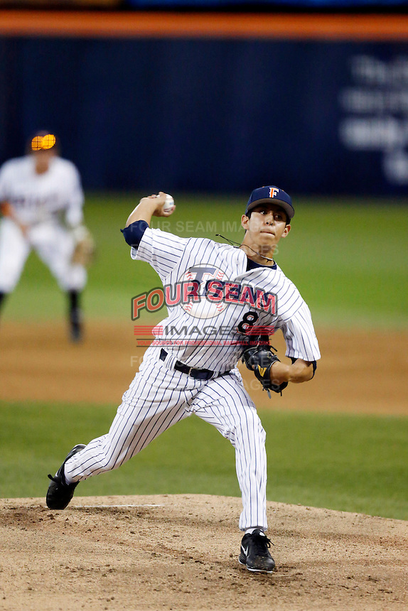 Justin Garza #8 of the Cal State Fullerton Titans pitches against the Nebraska Cornhuskers at Goodwin Field on February 16, 2013 in Fullerton, California. Cal State Fullerton defeated Nebraska 10-5. (Larry Goren/Four Seam Images)