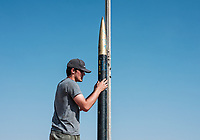 Cale Crawford from the University of Missouri Colombia, preps his rocket for launch at the Spaceport America Cup near the town of Truth or Consequences, New Mexico, June 20-24, 2017. The International Intercollegiate Rocket Engineering Competition hosted over 110 teams from colleges and universities in eleven countries. Students launched solid, liquid, and hybrid rockets to target altitudes of 10,000 and 30,000 feet. The 2017 Spaceport America Cup winner was the University of Michigan, Ann Arbor, Team 79.<br /> <br /> Photo by Matt Nager