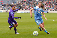 Bridgeview, IL, USA - Sunday, May 1, 2016: Orlando Pride defender Kristen Edmonds (12) and Chicago Red Stars defender Katie Naughton (5) during a regular season National Women's Soccer League match between the Chicago Red Stars and the Orlando Pride at Toyota Park. Chicago won 1-0.