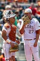 Texas Longhorns catcher Tres Barrera (1) talks with pitcher Travis Duke (27) on the mound during the NCAA Super Regional baseball game against the Houston Cougars on June 7, 2014 at UFCU Disch–Falk Field in Austin, Texas. The Longhorns are headed to the College World Series after they defeated the Cougars 4-0 in Game 2 of the NCAA Super Regional. (Andrew Woolley/Four Seam Images)