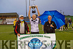 Shane Kenny captain of Castlegregory Celtic accepts the Denny Division 1A League Final Cup from Sean O'Keefe (Chairman KDL) and John O'Regan (Sec KDL)