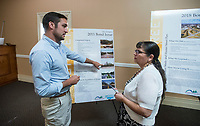 NWA Democrat-Gazette/BEN GOFF @NWABENGOFF<br /> Ben Cline, public relations manager for the City of Rogers, talks to Angela Argueta of Rogers Wednesday, Aug. 1, 2018, during a bond issue public information presentation at Centro Christiano in Rogers. The presentation included information in English and Spanish about the City of Rogers 2018 Bond Issue that includes funding for parks, streets, fire department and police department projects.