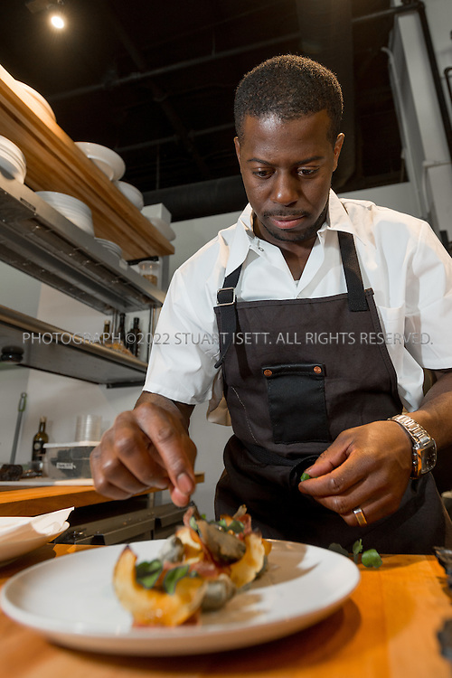 10/23/2015&mdash;Seattle, WA, USA<br /> <br /> Salare restaurant, owned by chef Edouardo Jordan originally from St. Petersburg, Florida. <br /> <br /> Here Mr. Jordan prepares a salad made with delicate squash, Asian pears, breasola, okra and egusi sauce with water cress.<br /> <br /> Salare is a chef-driven neighborhood restaurant, in the Ravenna neighborhood in North Seattle, that captures America&rsquo;s diverse culture of food with influences from America&rsquo;s South, Africa, Europe and the Caribbean Islands.<br /> <br /> Photograph by Stuart Isett<br /> &copy;2015 Stuart Isett. All rights reserved.
