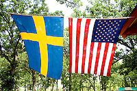 Swedish and American flags hanging side by side. Svenskarnas Dag Swedish Heritage Day Minnehaha Park Minneapolis Minnesota USA