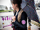 A participant at a rally calling on president Obama to ensure the United States is a leader in providing comprehensive, post-rape care, including safe abortion services, to survivors of sexual violence looks toward the White House in Washington, DC. <br /> <br /> PHOTOS/John Nelson
