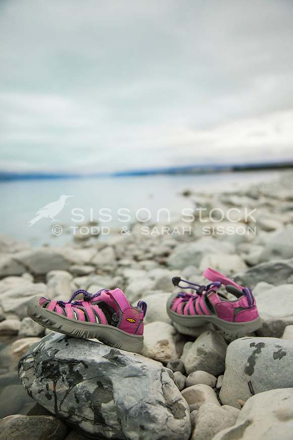 Pink shoes at the edge of Lake Pukaki, Canterbury, New Zealand - stock photo, canvas, fine art print