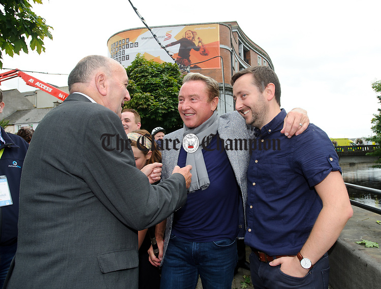 Pat Liddy and Gary Collins, former Lord Of The Dance member chatting with Michael Flatley at the official opening of the All-Ireland Fleadh 2017 in Ennis. Photograph by John Kelly.