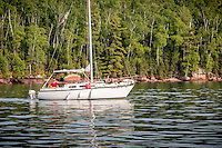 Sailboat anchored in Presque Isle Bay on Stockton Island in the Apostle Islands National Lakeshore near Bayfield Wisconsin.