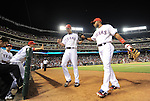 Yu Darvish (Rangers),<br /> AUGUST 30, 2013 - MLB :<br /> Yu Darvish of the Texas Rangers high-fives teammates Elvis Andrus and Martin Perez on his way back to the dugout during the Major League Baseball game against the Minnesota Twins at Rangers Ballpark in Arlington in Arlington, Texas, United States. (Photo by AFLO)