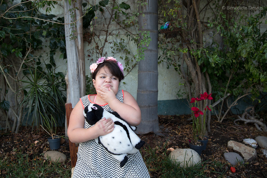 "Ana Ximena Navarro is pictured at her home in Guadalajara, Mexico on February 22, 2017. Ximena was diagnosed as an infant with Hurler syndrome. Hurler syndrome is the most severe form of mucopolysaccharidosis type 1 (MPS1), a rare lysosomal storage disease, characterized by skeletal abnormalities, cognitive impairment, heart disease, respiratory problems, enlarged liver and spleen, characteristic facies and reduced life expectancy. Ximena was being given enzyme replacement therapy (ERT) when she was 19 months old, and she was suddenly able to eat and sleep. She is now 12, and has normal hormonal development for her age, although some mental delay, according to her father. ""Without the treatment, she would have died from all the complications — untreated, children have a very bad quality of life and typically die before they are seven"", her father says. Photo credit: Bénédicte Desrus"