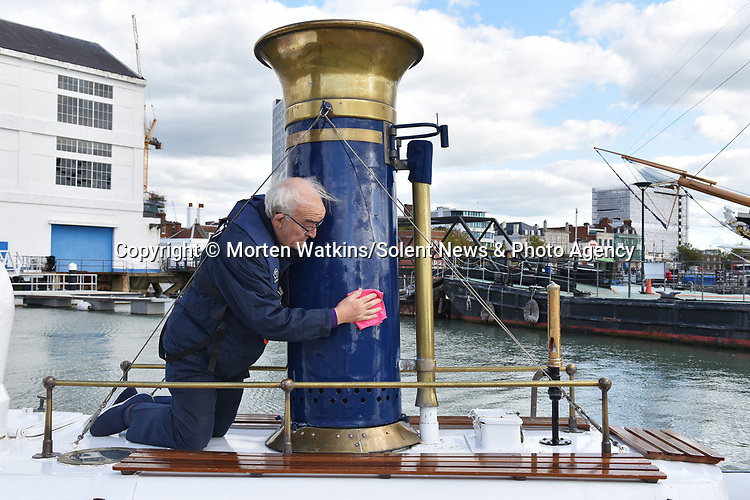 Pictured: Restoration volunteer Martin Marks polishes the solid brass funnel of Pinnace 199.<br /> <br /> An historic 100 year old Royal Navy steam ship has finally been returned to its former glory after a painstaking restoration process.<br /> <br /> The 50ft-long Steam Pinnace 199 is believed to be the last remaining boat of its type in operational service.<br /> <br /> For years, the significance of the boat, which was built in 1911, was lost on various owners and it languished at the side of the Thames for more than 20 years as a static houseboat.<br /> <br /> Her steam engine was even replaced by a petrol engine.<br /> <br /> However, before the vessel disappeared forever beneath a Thames mud bank, she was recognised for the proud little ship she once was and rescued by a group of volunteers, who called themselves Group 199.   SEE OUR COPY FOR DETAILS.<br /> <br /> © Morten Watkins/Solent News & Photo Agency<br /> UK +44 (0) 2380 458800