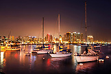 USA, California, San Diego, a few sailboats moored in the San Diego Bay waterfront at night