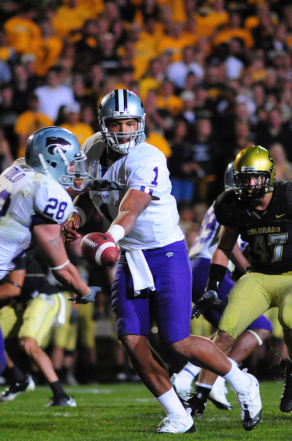 18 October 08: Kansas State quarterback Josh Freeman hands off to running back Logan Dold on a play against Colorado. The Colorado Buffaloes defeated the Kansas State Wildcats 14-13 at Folsom Field in Boulder, Colorado.