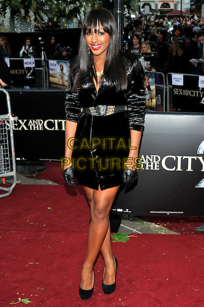 "ALEXANDRA BURKE.Attending the ""Sex And The City 2"" UK film premiere, Odeon Leicester Square, London, England, UK..May 27th 2010.arrivals full length shirt silk satin black dress gloves gold waist belt shoulder shoulder pads .CAP/PL.©Phil Loftus/Capital Pictures."