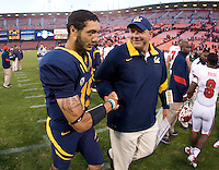 Zach Maynard of California shakes hands with Offense Coordinator coach Jim Michalczik after the game at Candlestick Park in San Francisco, California on September 3rd, 2011.  California defeated Fresno State, 36-21.