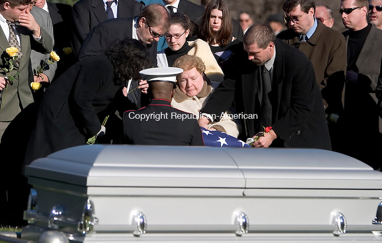 SEYMOUR, CT- 19 DEC 06- 121906JT09- <br /> A Marine honor detail presents the American flag that was draped over the coffin of Walter Krauchick to Krauchick's wife Pauline Piotrowski Krauchick during his funeral at Mountain Meadows Cemetery in Seymour on Tuesday. Walter Krauchick was a retired Gunnery Sargeant in the US Marine Corps and served in WWII, Korea, and Vietnam during his 24 years of service. <br /> Josalee Thrift Republican-American