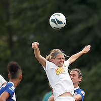 Western New York Flash substitute midfielder Ingrid Wells (9) and Boston Breakers midfielder Heather O'Reilly (9) battle for head ball.  In a National Women's Soccer League (NWSL) match, Boston Breakers (blue) tied Western New York Flash (white), 2-2, at Dilboy Stadium on August 3, 2013.