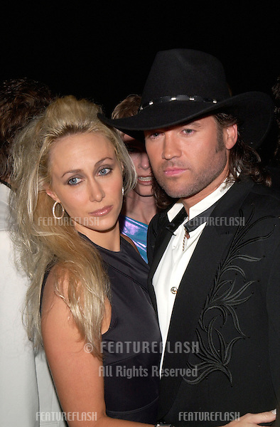 Country singer BILLY RAY CYRUS & wife at the BMI Country Awards in Nashville.