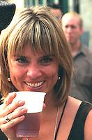 Woman age 23 enjoying a beer on Bastille day.  Minneapolis Minnesota USA