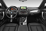 Stock photo of straight dashboard view of a 2015 BMW 1 Series M Sport 5 Door Hatchback Dashboard