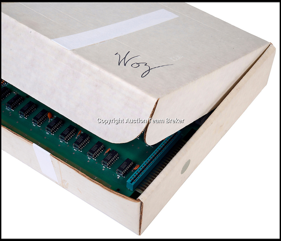 """BNPS.co.uk (01202 558833)<br /> Pic: ATBreker/BNPS<br /> <br /> Steve Wozniak signed the keyboard and its original box.<br /> <br /> Humble beginnings of a billion pound business.<br /> <br /> An incredibly rare Apple 1 computer, the 46th ever built and one of just a handful of Apple 1's in existence.<br /> <br /> Dubbed the """"world's best"""" Apple 1, it has been put up for sale for £500,000.<br /> <br /> Included in the sale is a picture of the early production line in Steve Job's bedroom dating from 1976."""