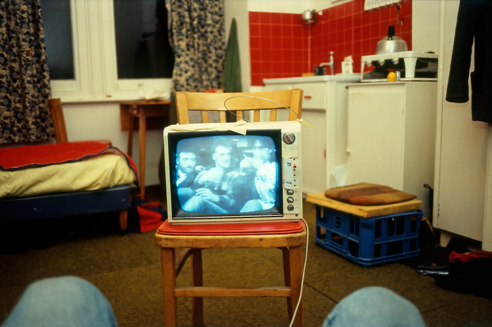 A night in watching TV in a bedsit in London. England 1986.