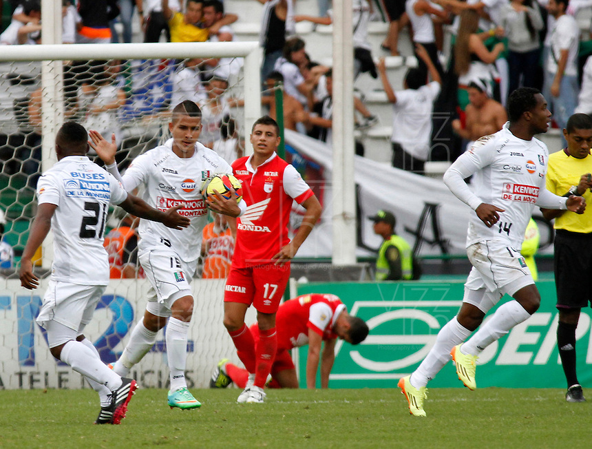 MANIZALES -COLOMBIA, 06-04-2014. Cesar Augusto Arias y Cristian Palomeque de Once Caldas  celebra el gol anotado al Independiente Santa Fe durante la fecha 15 de la Liga Postobón I 2014 jugado en el estadio Palogrande de la ciudad de Manizales./  Once Caldas  Cesar Augusto Arias and Cristian Palomeque  celebrates a scored goal discover Independiente Santa Fe  during a match for the 15th date of the Postobon  League I 2014 at Palogrande stadium in Manizales city. Photo: VizzorImage/Santiago Osorio/STR