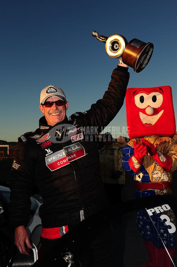 Oct. 30, 2011; Las Vegas, NV, USA: NHRA pro stock driver Mike Edwards celebrates after winning the Big O Tires Nationals at The Strip at Las Vegas Motor Speedway. Mandatory Credit: Mark J. Rebilas-