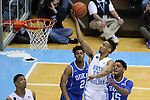07 March 2015: North Carolina's J.P. Tokoto (13) gets behind Duke's Quinn Cook (2) and Jahlil Okafor (15) and lays the ball in. The University of North Carolina Tar Heels played the Duke University Blue Devils in an NCAA Division I Men's basketball game at the Dean E. Smith Center in Chapel Hill, North Carolina. Duke won the game 84-77.