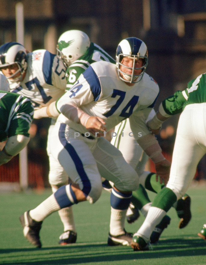 Los Angeles Rams Merlin Olsen (74) in action during a game from his 1969 season with the Los Angeles Rams.  Merlin Olsen  played for 15 seasons, all with Los Angeles Rams, was a 14-time Pro Bowler and was inducted to the Pro Football Hall of Fame in 1982.<br /> (SportPics)