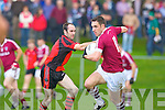 Declan O'Sullivan Dromid goes past Bernard Murphy Glenbeigh/Glencar during their Junior Championship semi final on Sunday