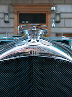 The Bentley insignia, recognised throughout the world, on the chrome radiator cover of an iconic Bentley Blower outside the St Regis Hotel in New York