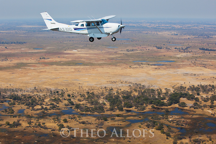 Botswana, Moremi Game Reserve, bush plane flying above Okavango Delta, aerial view