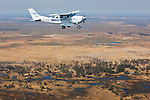 Botswana, Moremi Game Reserve, bush plane flying above Okavango Delta, aerial view