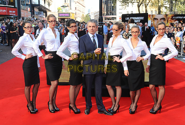 Rowan Atkinson.'Johnny English Reborn' UK Premiere at Empire Leicester Square, London, England..2nd October 2011.full length black suit posing shirt pencil skirt white hands on hips glasses .CAP/BEL.©Tom Belcher/Capital Pictures.