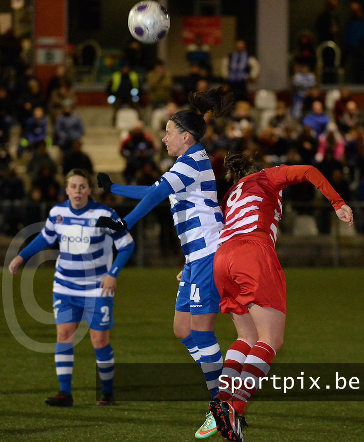 20140221 - OOSTAKKER , BELGIUM : duel pictured with Gent Kay Cuvelier (l)  during the soccer match between the women teams of AA Gent Ladies  and RAFC Antwerp Ladies , on the 19th matchday of the BeNeleague competition Friday 21 February 2014 in Oostakker. PHOTO DAVID CATRY