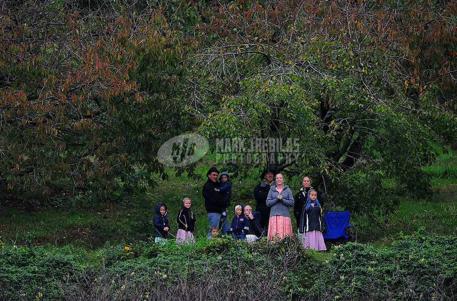 Oct. 2, 2011; Mohnton, PA, USA: An amish family watches NHRA racing from a hill near the track during the Auto Plus Nationals at Maple Grove Raceway. Mandatory Credit: Mark J. Rebilas-