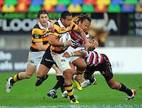 Tana Umaga tries to tackle Taranaki winger David Smith. ITM Cup rugby match - Taranaki v Counties-Manukau Steelers at Yarrow Stadium, New Plymouth, New Zealand on Sunday 12 September 2010. Photo: Dave Lintott/lintottphoto.co.nz.
