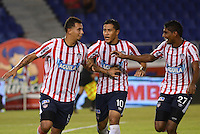 BARRANQUILLA- COLOMBIA - 25-09-2013: Luis C Ruiz (Cent.), Maicol Ortega (Der.) y Edwin Cardona (Izq.) jugadores del Atletico Junior celebran el gol anotado durante el partido en el estadio Metropolitano Roberto Melendez de la ciudad de Barranquilla, septiembre 25 de 2013. Atletico Junior y Deportes Quindio durante partido por la undecima  fecha de las de la Liga Postobon II. (Foto: VizzorImage / Alfonso Cervantes / Str).  Luis C Ruiz (C), Maicol Ortega (R) and Edwin Cardona (L) playeres of Atletico Junior celebrate a goal scored during a math in the Metropolitano Roberto Melendez Stadium in Barranquilla city, September 25, 2013. Atletico Junior and Deportes Quindio in a match for the eleventh round of the Postobon League II. (Photo: VizzorImage / Alfonso Cervantes / Str).