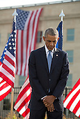 United States President Barack Obama bows his head during a ceremony at the Pentagon to mark the 13th anniversary of the September 11th, 2001 terrorist attacks, in Washington, Thursday, September 11, 2014.<br /> Credit: Martin Simon / Pool via CNP