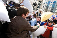 """People celebrate International Pillow Fight Day in New York's Union Square.  The pillow fight is a fun, free event that is part of the urban playground movement, an effort to get people outside their homes and celebrate public spaces as """"urban living rooms."""""""